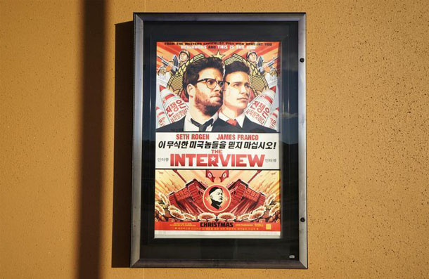 The promotional poster for The Interview, a Hollywood satirical comedy film depicting an assassination plot against North Korean leader Kim Jong-un. (Photo: Rick Wilking / Reuters)