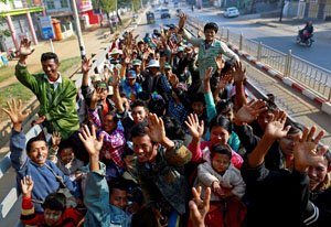 Migrant workers who fled from Karmine ride a vehicle to return home, from a temporary refugee camp in Lashio