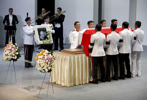Pallbearers carry the casket of former leader Lee Kuan Yew as they depart for the final journey to the crematorium at the National University of Singapore on Sunday. (Photo: Edgar Su / Reuters)