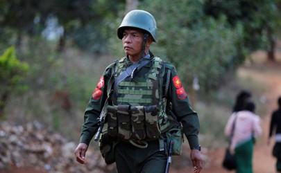 A Burma Army solider patrols in Lashio, Shan State, on Feb. 20, 2015. (Photo: Reuters)