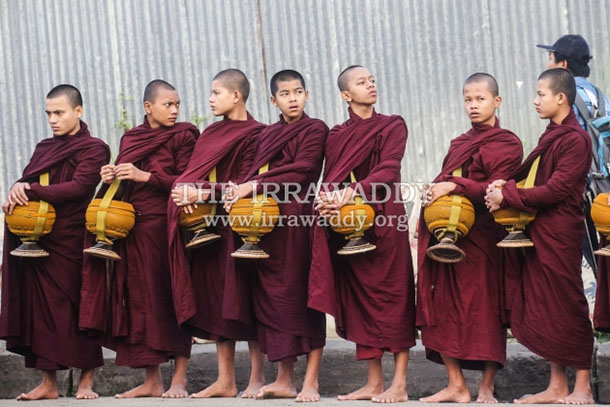 A group of young monks in Rangoon prepare to collect alms. (Photo: JPaing / The Irrawaddy)