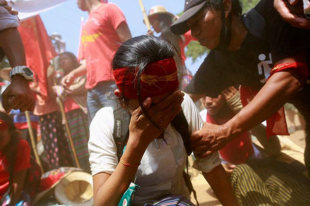 A female student cries amid a violent crackdown by police on student protestors at Letpadan, Pegu Division, on Tuesday, March 10. (Photo: Soe Zeya Tun / Reuters)