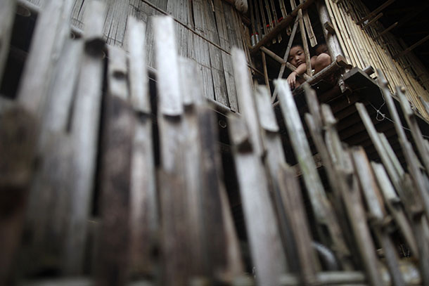Ethnic Karen children from Burma look out from inside their shelter at the Mae La refugee camp outside Mae Sot near the Thai-Burma border in 2010. (Photo: Reuters)