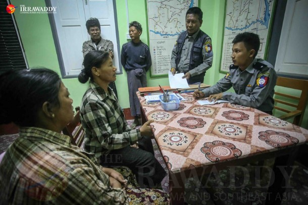 Family members of Khin Win, who was killed by police during a protest on Monday, file a report concerning her death at Salingyi Township Police Station on Dec. 23. (Photo: JPaing / The Irrawaddy)