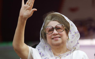 BNP Chairperson Khaleda waves to activists as she arrives for a rally in Dhaka