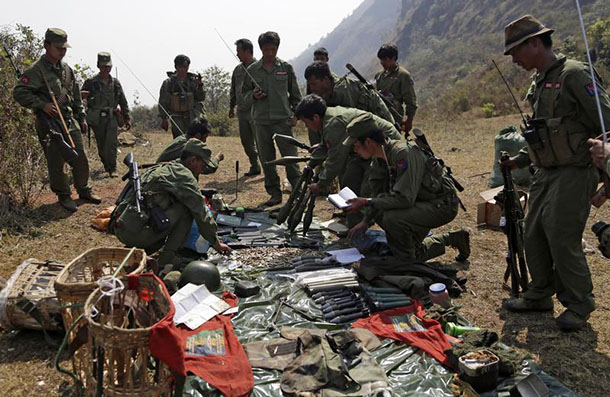 Soldiers of the Myanmar National Democratic Alliance Army inspect arms and ammunition in the Kokang region on Mar. 10. (Photo: Reuters)