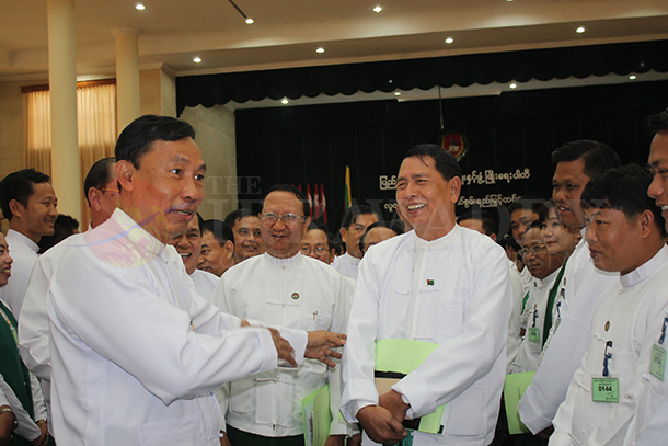 USPD chairman Shwe Mann talks with USPD members during a party meeting in May 2013. (Photo: Nan Thiri Lwin / The Irrawaddy)