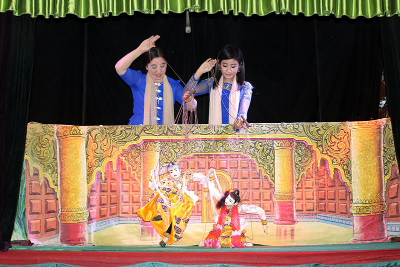 Ma Toe Toe and Ma Han Su Yin work the puppets at Mandalay Marionettes Theater. (Photo: Nyein Nyein / The Irrawaddy)