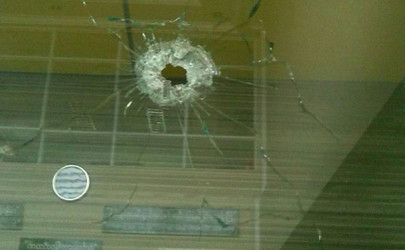 A window shattered by armed attackers at the Muse branch of Myawaddy Bank. (Photo: Myawaddy Newspaper / Facebook)