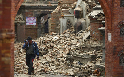 A man cries as he passes by a damaged statue of Buddha in Bhaktapur, Nepal on Sunday. (Photo: Navesh Chitrakar / Reuters)