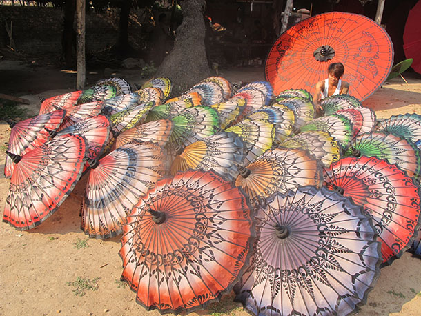 Pathein parasols are put on display outside a workshop in the Irrawaddy Delta town. (Photo: Salai Thant Zin / The Irrawaddy)