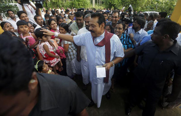 Sri Lanka's President Mahinda Rajapaksa greets supporters after casting his vote for the presidential election in January. (Photo: Dinuka Liyanawatte / Reuters)