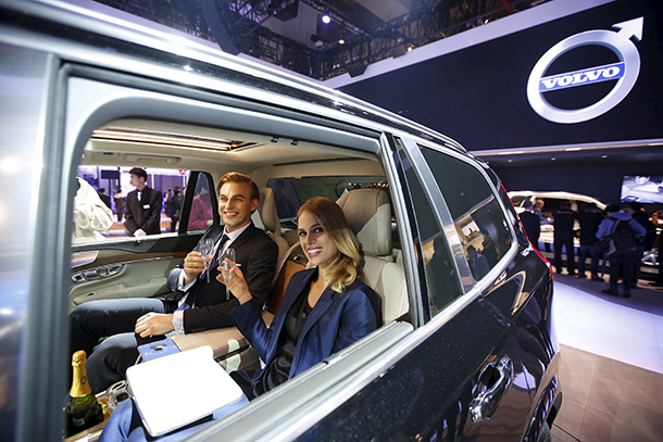 Models pose inside a Volvo XC 90 at the 16th Shanghai International Automobile Industry Exhibition in Shanghai on Apr. 20. (Photo: Aly Song / Reuters)