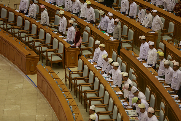 Lawmakers stand as the parliamentary speaker, unseen, enters during a Union Parliament regular session in Naypyidaw on March 26, 2015. (Photo: Reuters)