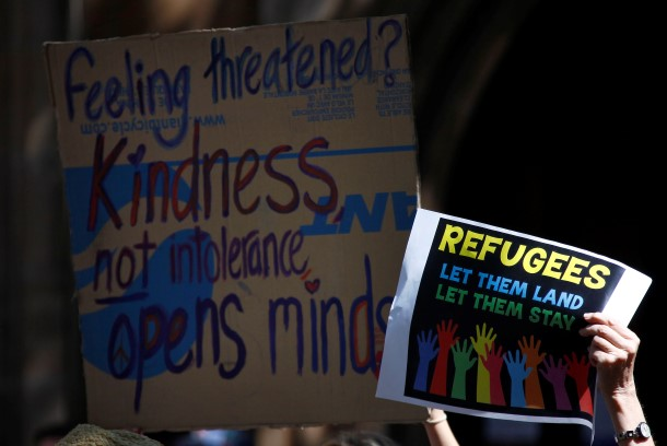 Protesters hold placards at a 'Stand up for Refugees' rally held in central Sydney on Oct. 11, 2014. (Photo: Reuters)