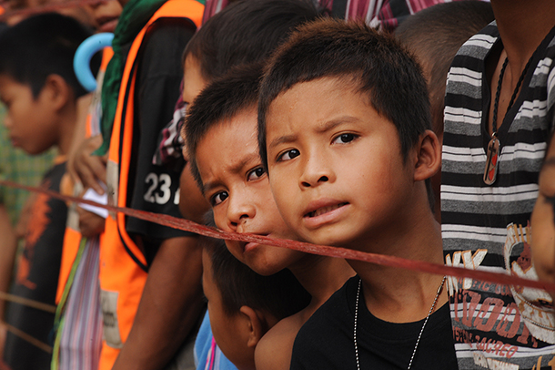 Two young Karen children at Thailand's Mae La refugee camp in June 2012, awaiting a visit from National League for Democracy chairwoman Aung San Suu Kyi. (Photo Steve Tickner / The Irrawaddy)