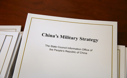 Copies of the annual white paper on China's military strategy are placed on a table for distribution to journalists during a news conference in Beijing on May 26, 2015. (Photo: Reuters)