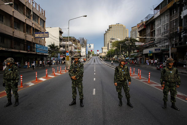 Thai soldiers stand guard along roads blocked around the Victory Monument, where anti-coup protesters were gathering on previous days, in Bangkok on May 30, 2014. (Photo: Reuters)