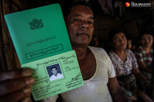 Moe Rue Husom, who also goes by Min Aung, shows a green ID card he received in 2014, indicating that he is a naturalized citizen under Burma's 1982 Citizenship Law. (Photo: JPaing / The Irrawaddy)