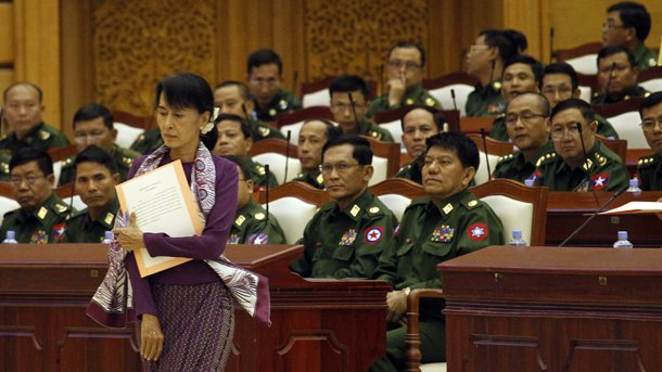 Aung San Suu Kyi walks past military MPs as she is about to take the admission oath in Burma's Parliament in 2012. (Photo: Reuters)
