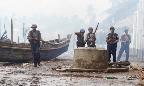 Police stand guard in Sittwe, the capital of Arakan State, in this June 2012 photo, after communal violence saw houses torched and residents driven from their homes. (Photo: Reuters)