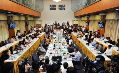 Ethnic representatives meet with government negotiators in Rangoon on July 22 for the opening day of the eighth round of talks on a nationwide ceasefire agreement. (Photo: Steve Tickner / The Irrawaddy)