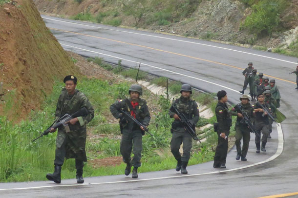 Border Guard Force troops patrol the Asia Highway in Karen State. (Photo: Kyaw Kha / The Irrawaddy)