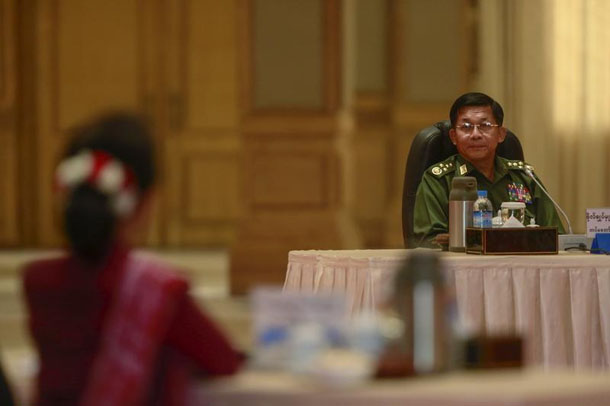 Myanmar military Commander-in-chief Senior General Min Aung Hlaing looks to Myanmar pro-democracy leader Aung San Suu Kyi during talks in Naypyidaw in April. (Photo: Soe Zeya Tun / Reuters)