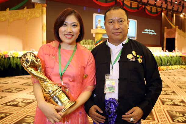 Nang Lang Kham and her father, regime-friendly Aung Ko Win, at a ceremony in Naypyidaw honoring Kanbawza bank as the nation's top taxpayer last year. (Photo: JPaing / The Irrawaddy)