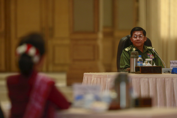 Military commander in chief Snr-Gen Min Aung Hlaing looks to Burma's pro-democracy leader Aung San Suu Kyi during top six-party talks at the Presidential Palace in Naypyidaw on April 10, 2015. (Photo: Reuters)