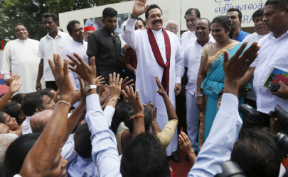 Sri Lanka's former president Mahinda Rajapaksa waves at his supporters in Colombo during the launch ceremony of his election manifesto on Tuesday. (Photo: Dinuka Liyanawatte / Reuters)