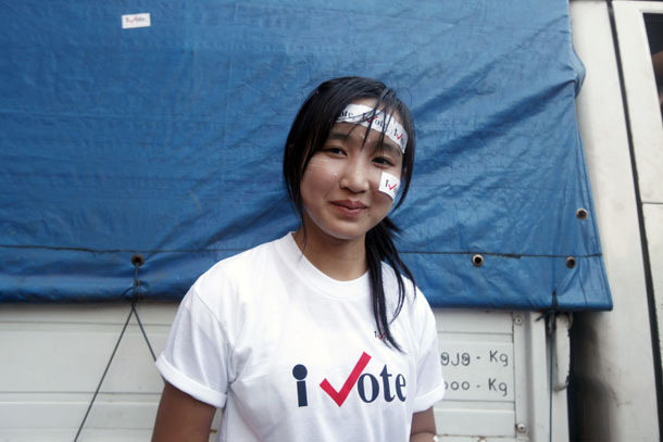 A woman smiles in Rangoon on Nov. 5, 2010, as she takes part in an 'I Vote' campaign ahead of Burma's 2010 general election. (Photo: Soe Zeya Tun / Reuters)