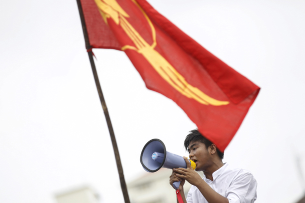 Student leader ZeyaLwin gives a speech during a protest against military representatives in Parliament in front of City Hall in Rangoon on June 30, 2015. (Photo: Reuters)