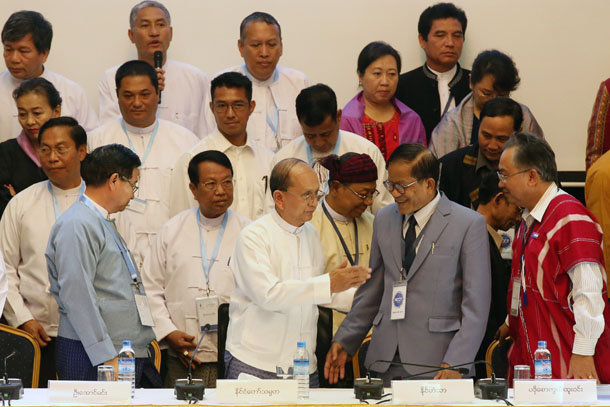 Ethnic leaders and government negotiators commit to a draft Nationwide Ceasefire Agreement at the Myanmar Peace Center in Rangoon on March 31, 2015. (Photo: JPaing / The Irrawaddy)