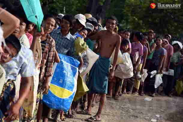 Displaced villagers line up for food rations in Pwintbyu, Pegu Division on Wednesday evening. (Photo: J Paing/The Irrawaddy)