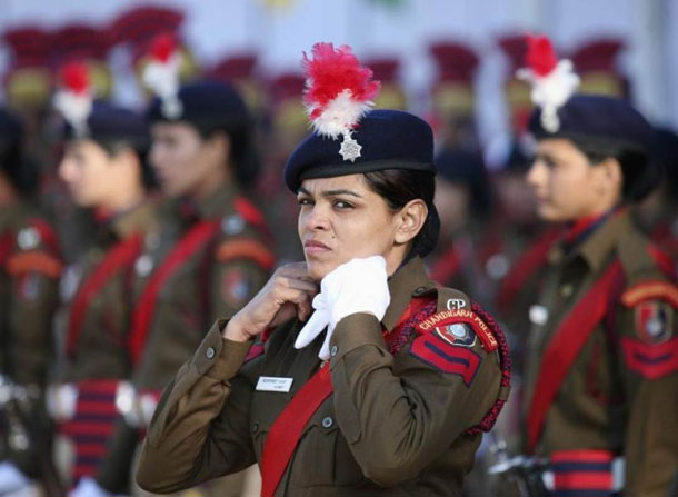 A policewoman adjusts her neck scarf during a 2013 Republic Day parade in the northern Indian city of Chandigarh. (Photo: Ajay Verma / Reuters)