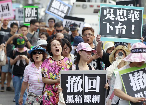 Activists march on the street during a protest in front of the Ministry of Education in Taipei, Taiwan on Sunday. (Photo: Pichi Chuang / Reuters)