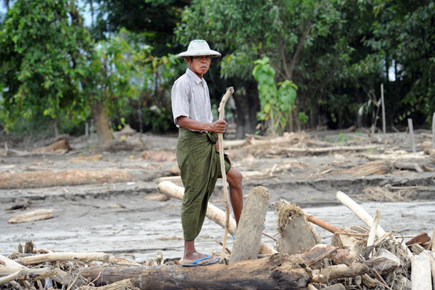 Rice farmer, Tin Aung, surveys what remains of his ten acres of rice paddy in Chin Sone village on the outskirts of Kale, Sagaing Division. (Photo: Steve Tickner / The Irrawaddy)