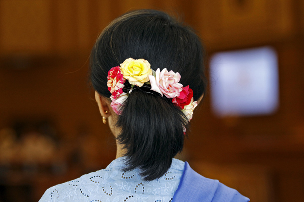 Burma's pro-democracy leader Aung San Suu Kyi, wearing her trademark flowers in her hair, arrives for a session of parliament in Naypyidaw April 3, 2015. (Photo: Reuters)