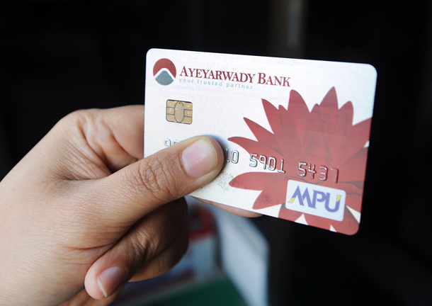 Burma's sole domestic provider of card-based payments, Myanmar Payment Union, announced in early September the formation of a public company. (Photo: Steve Tickner / The Irrawaddy)