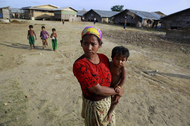 Roshida, a 25-year-old widow who was released from a human trafficking ship, is seen at a refugee camp outside Sittwe on May 20, 2015. (Photo: Soe Zeya Tun / Reuters)