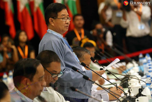 The government's chief peace negotiator Aung Min addresses a multi-stakeholder meeting on post-ceasefire political dialogue held in Rangoon on Monday. (Photo: JPaing / The Irrawaddy)