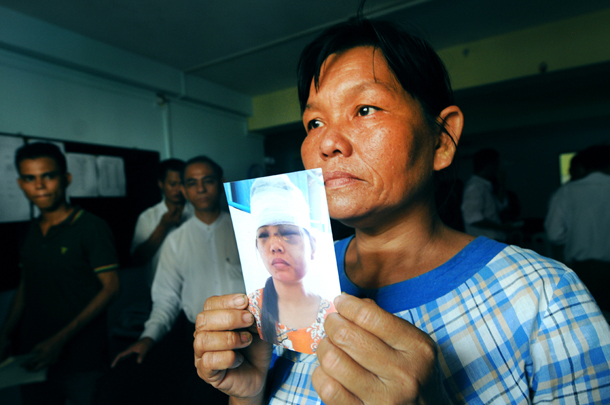 The mother of a 23-year-old housekeeper who says she was abused by her Rangoon employer. (Photo: Steve Tickner / The Irrawaddy)