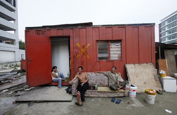 Foreign workers from Indonesia chat outside a cabin at their quarter in Kuala Lumpur June 19, 2011. (Photo: Reuters)