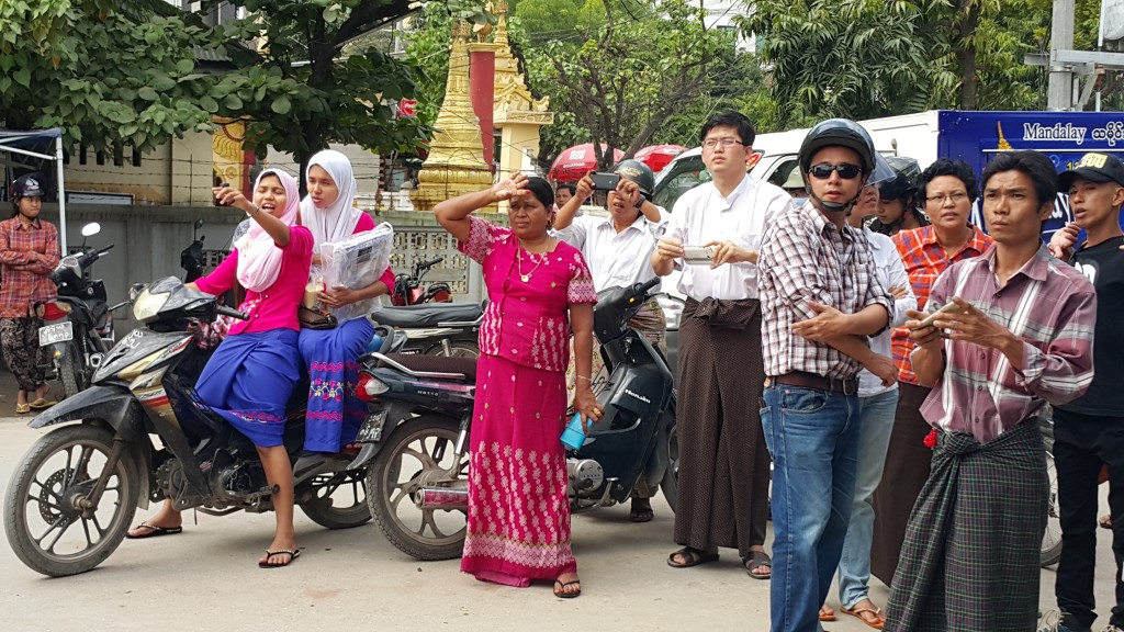 Mandalay locals outside NLD headquarters on Monday morning. (Photo: Teza Hlaing / The Irrawaddy)