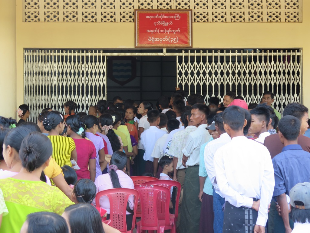 Soldiers and their families outside a cantonment polling station in Pathein. (Photo: Salai Thant Zin / The Irrawaddy)