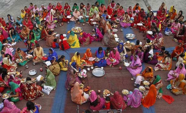 Women pray during the Hindu festival of Karva Chauth at a temple in Chandigarh, India, on Oct. 30. (Photo: Ajay Verma / Reuters)