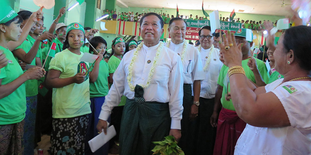 Ohn Myint, the incumbent chief minister of Mon State, at Mudon's Shwe Hinthar hall in Mon State on Friday where he gave a speech to supporters. (Yen Snaing / The Irrawaddy)