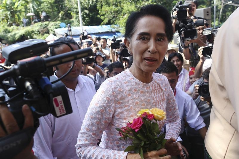 Aung San Suu Kyi arrives at her party headquarters on Monday morning. (Photo: Soe Zeya Tun / Reuters)