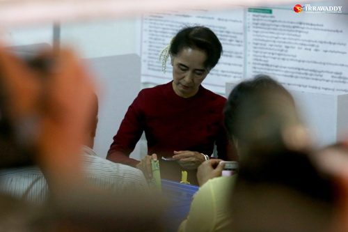 National League for Democracy chairwoman Aung San Suu Kyi casts a vote in Rangoon's Bahan Township on Sunday. (Photo: Hein Htet / The Irrawaddy)